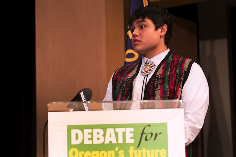 TRIBUNE PHOTO: JAIME VALDEZ - Dazen Sigo of Pendleton asked candidates about adding courses in Native American history to high schools across the state.