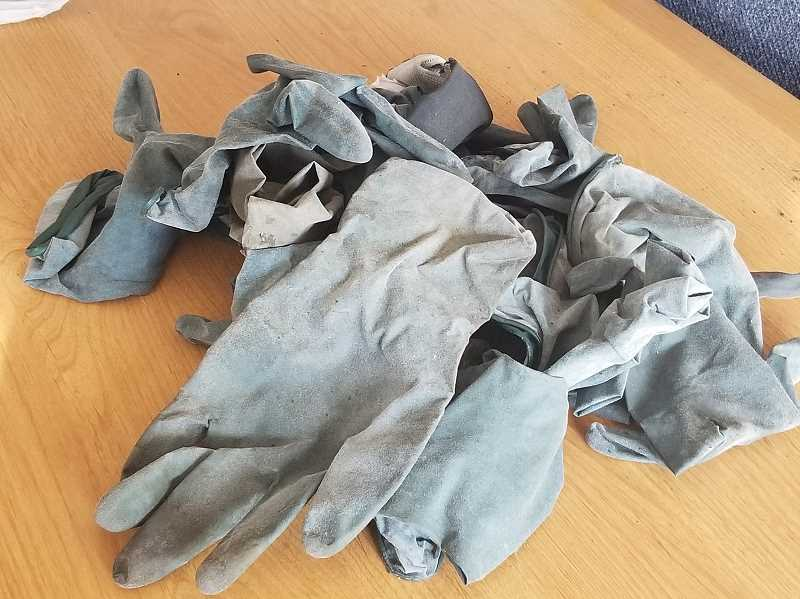 REVIEW PHOTO - Lake Oswego resident Annie Arkebauer found these gloves near A Avenue and State Street in downtown Lake Oswego. Where did they come from?