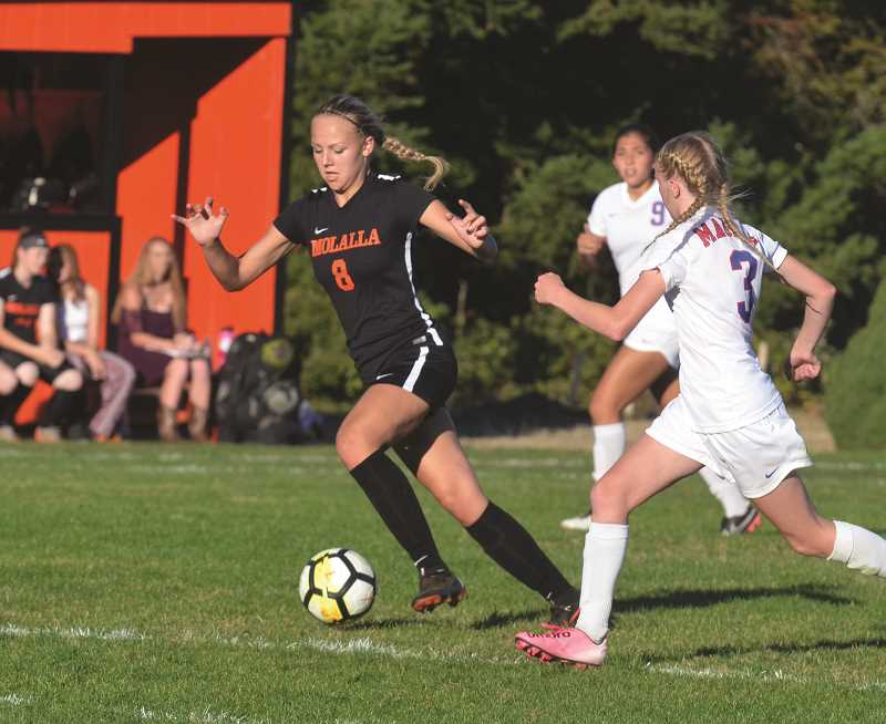 PIONEER PHOTO: TANNER RUSS - Junior Madeline Lisac had two goals against the Madras White Buffalo in their first encounter.