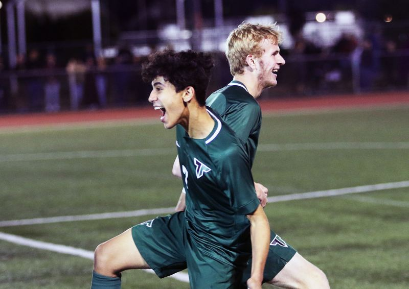 TIMES PHOTO: DAN BROOD - Tigard High School junior Rasheed Tarhuni (left) and sophomore Jack Hallam are all smiles folling the Tigers 3-2 win over rival Tualatin on Tuesday.