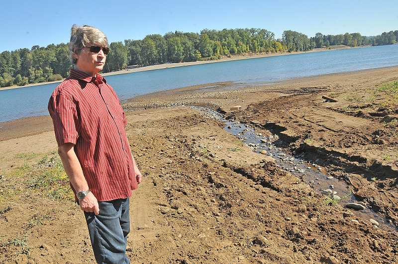 TIDINGS PHOTO: VERN UYETAKE - Bill Buan says he wouldn't trade his 35 years along the river for anything else, but issues with erosion and rusting stormwater pipes in recent years have become a growing concern.