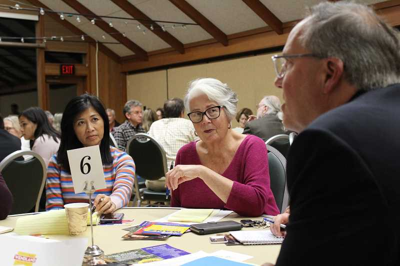 REVIEW PHOTO: SAM STITES - Lake Oswego residents Corinne Strauser and Gail Parrick listen to council candidate John Wendland talk about the need to increase the community's access to public transportation during Monday's speed-dating forum at the Adult Community Center.