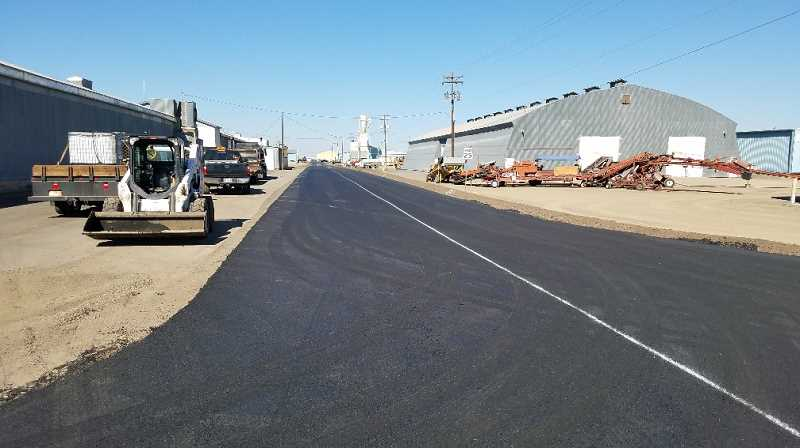 SUBMITTED PHOTO - Crews complete the paving on Northwest Conroy Street adjacent to Bright Wood, in the Madras Industrial Site.
