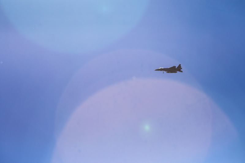 TRIBUNE PHOTO: JONATHAN HOUSE - A fighter jet flies over the skies of Northeast Portland.