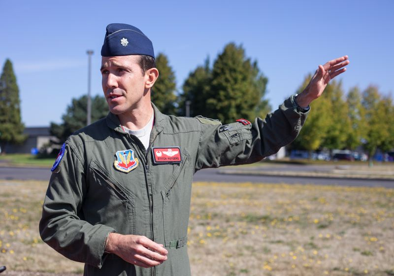 TRIBUNE PHOTO: JONATHAN HOUSE - Lt. Col. Nick Rutgers talks about the protocol of landing jets at the Oregon Air National Guard base.