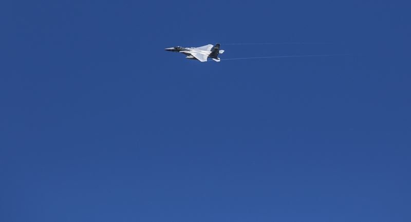 TRIBUNE PHOTO: JONATHAN HOUSE - A fighter jet flies over Northeast Portland.