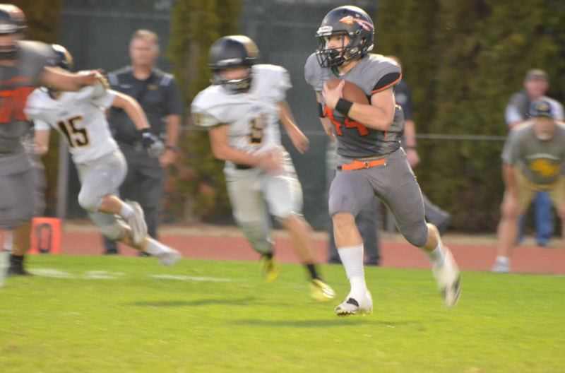 PHOTO COURTESY: JOHN BREWINGTON - Scappoose High senior Connor McNabb takes off on a kickoff return for a touchdown in the first minute of last week's game at home against St. Helens.