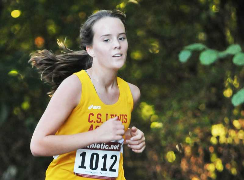 SETH GORDON - C.S. Lewis Academy junior Ally Trowbridge emerges from the woods at the Southwest Christian Invitational Friday in Beaverton.