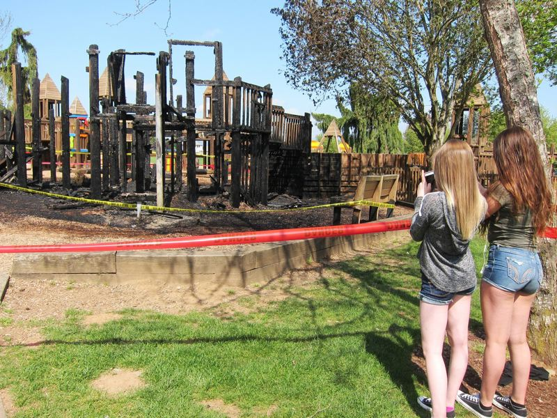 QUINTON SMITH - Children inspect the remains of Imagination Station.