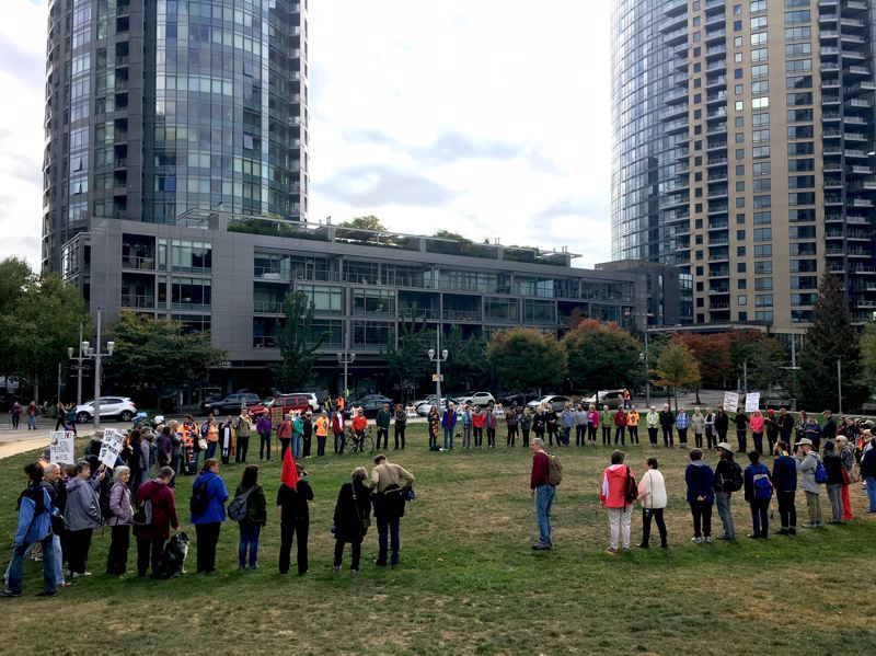 PAMPLIN MEDIA GROUP: JAIME VALDEZ - Dozens of people taking part in a seven-day walk to call attention to immigration issues gathered Thursday morning, Oct. 4, in Southwest Portland's Caruthers Park before rallying outside the Macadam Avenue ICE building.
