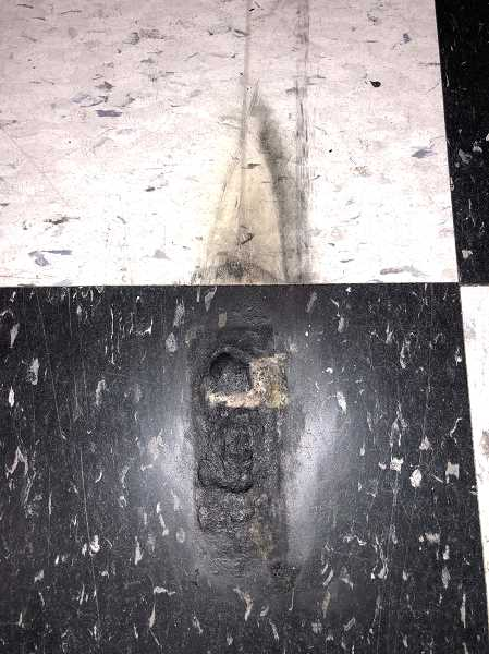 SUBMITTED PHOTO - The explosion left a charred dent in the floor at Comprite.