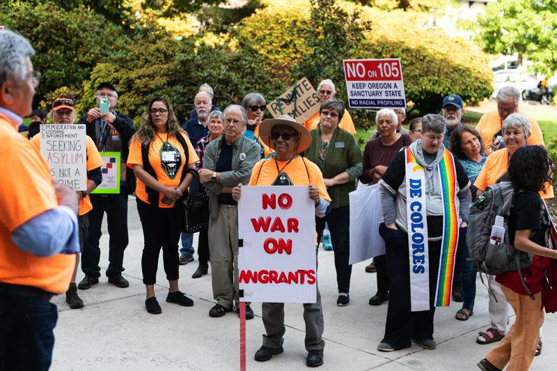 STAFF PHOTO: CHRISTOPHER OERTELL - 'No war on migrants' read one of the signs outside of the courthouse Wednesday.