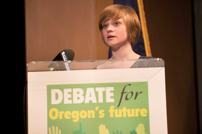 PAMPLIN MEDIA GROUP PHOTO: JAIME VALDEZ - Rose Lawrence, a sophomore at the School of Science and Technology in Beaverton, asked both main candidates for governor a question about LGBTQ suicides during the Tuesday night debate. Asked twice if she thought the candidates answered her questions, she said no.
