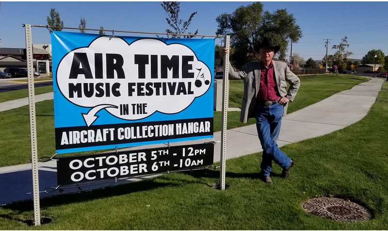 SUBMITTED PHOTO - Ray Pokorny stands next to the sign for the Air Time Music Festival, which will be held Oct. 5-6, at the Erickson Aircraft Collection. The Madras-Jefferson County Chamber of Commerce had the poles installed on the north and south ends of town, to help local organizations get the word out about their events.