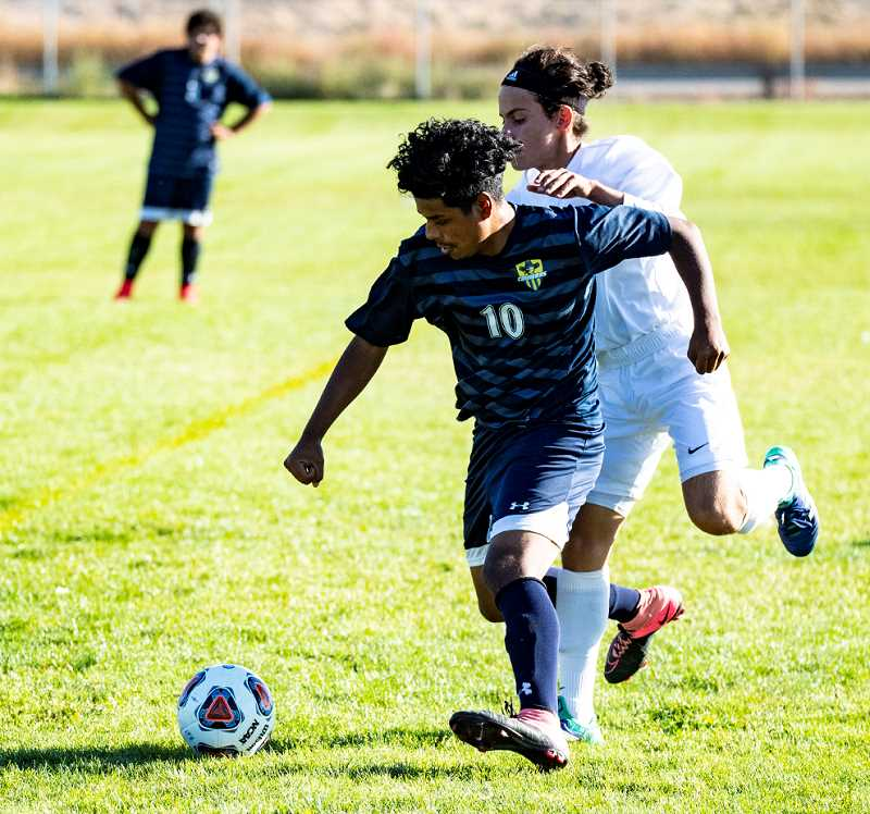 LON AUSTIN/CENTRAL OREGONIAN - Elias Villagomez, 10, plays the ball away from a player in a match earlier this year. Villagomez and the Cowboys fell 8-0 to the Ridgeview Ravens on Thursday, dropping their league record to 1-3.