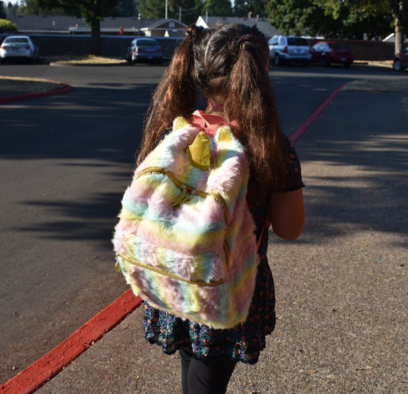 OUTLOOK PHOTO: TERESA CARSON - Cities and agencies are working to make it safer for kids to use human power to get to school like this little girl.