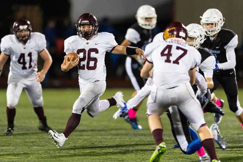 STAFF PHOTO: CHRISTOPHER OERTELL - Forest Grove junior running back Seth Peterson carries the ball during the Vikings' game against the Spartans, Oct. 5, at Hare Field in Hillsboro.