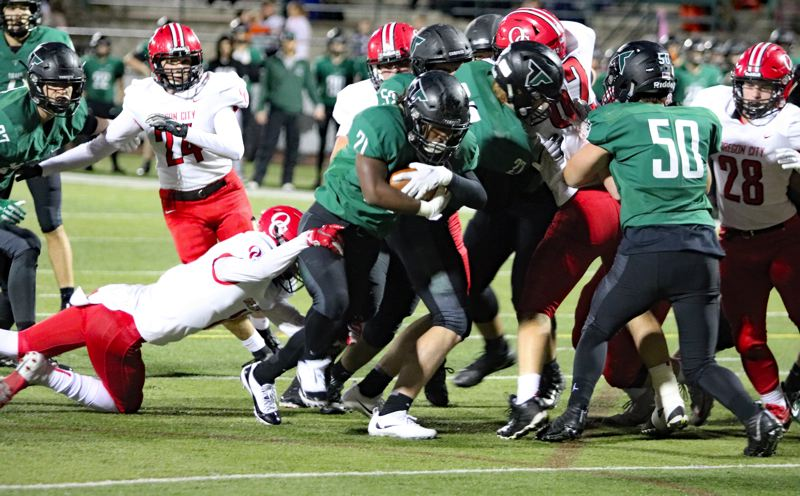 PAMPLIN MEDIA: JIM BESEDA - Tigard running back Malcolm Stockdale scores the first of his three rushing touchdowns from 3 yards out with 9:48 to play in the first quarter of Friday's home game against Oregon City.