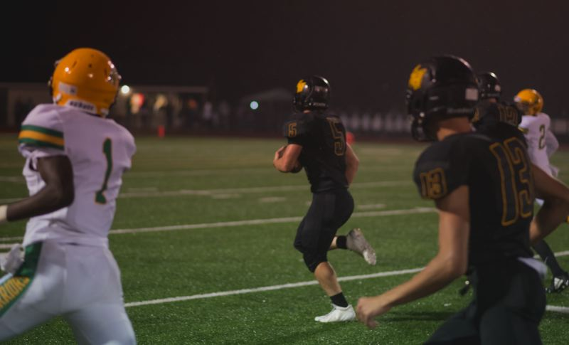 PHOTO COURTESY: JEREMY DUECK - Shawn Le of St. Helens takes off after making a reception and winds up scoring on a 75-yard pass play in the second quarter Friday night at home against Cleveland.