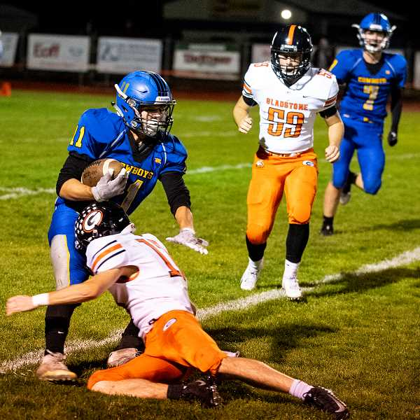 LON AUSTIN/CENTRAL OREGONIAN  - Jaxon Jedrykowski tackles Crook County's Jacob Kleffner during Gladstone's 14-6 victory over Crook County Friday night. The Gladiators held the Cowboys to just 164 yards of total offense in the game.