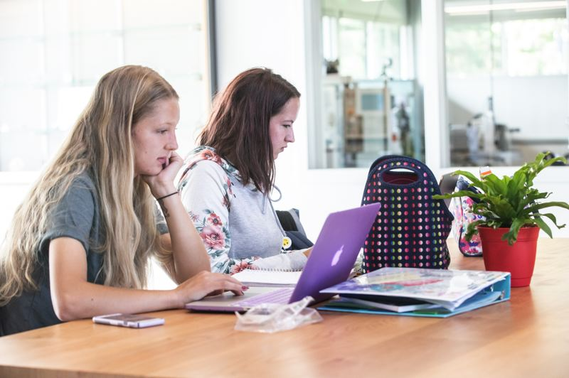 TRIBUNE PHOTO: JONATHAN HOUSE - Kelsey Houston, left, and Kreek Copher do school work in the new ITC building at Clackamas Community College.