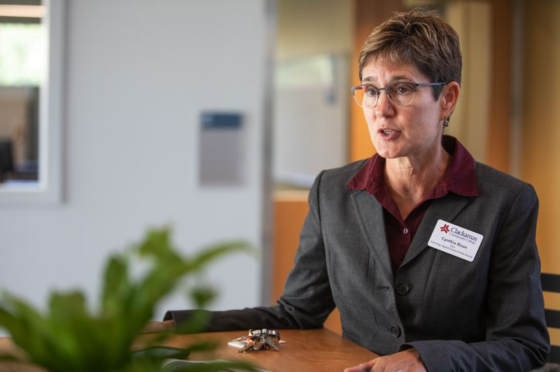 TRIBUNE PHOTO: JONATHAN HOUSE - Dean Cynthia Risan in the new ITC building at Clackamas Community College. She says the bond money has been well spent on making the workshop resemble the shop floor of a modern factory: clean, well-lit and not especially loud.