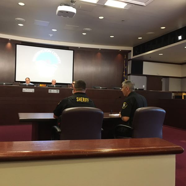 TIMES PHOTO: PETER WONG - Lt. John Bennett, left, and Sheriff Pat Garrett speak Oct. 2 to the Washington County Board of Commissioners during a presentation of Domestic Violence Awareness Month. Bennett leads a team of nine focused on domestic violence.