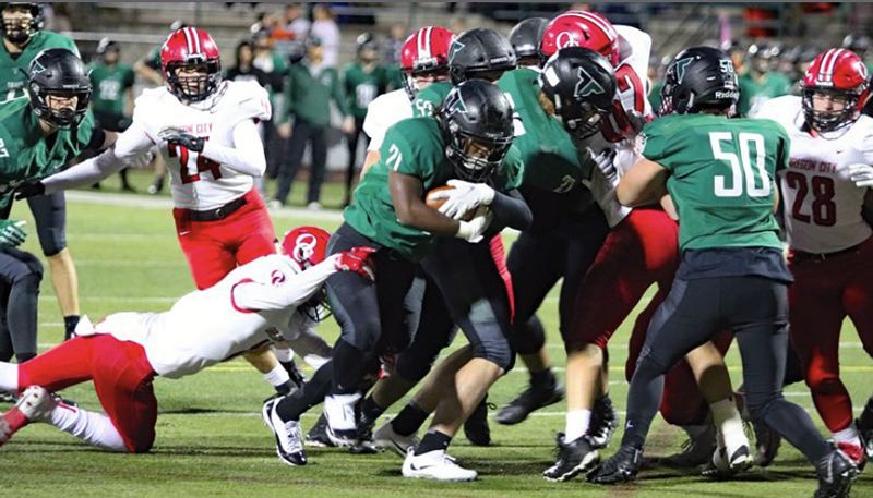 PAMPLIN MEDIA GROUP PHOTO: JIM BESEDA - Tigard running back Malcolm Stockdale scores the first of his three rushing touchdowns from 3 yards out with 9:48 to play in the first quarter of Friday's home game against Oregon City.