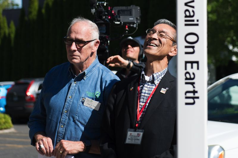 STAFF PHOTO: CHRISTOPHER OERTELL - Nyuzen Mayor Haruhito Sasajima, right, poses for pictures with Forest Grove Mayor Pete Truax at the dedication of a peace pole in Forest Grove in July.