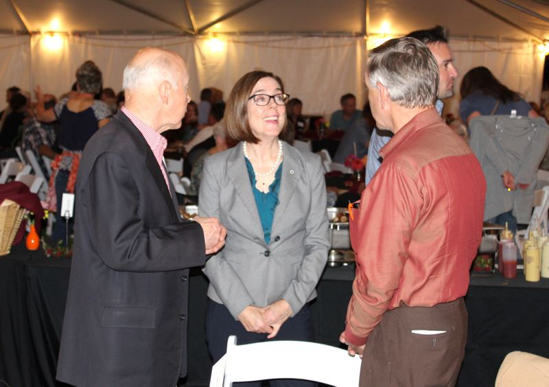 PHOTO BY: KIMBERLY JACOBSEN NELSON - Gov. Kate Brown speaks with Dr. Robert B. Pamplin Jr. (left) and Bill Boggess, interim dean of the OSU College of Agriculture Sciences, during social hour at the dinner.