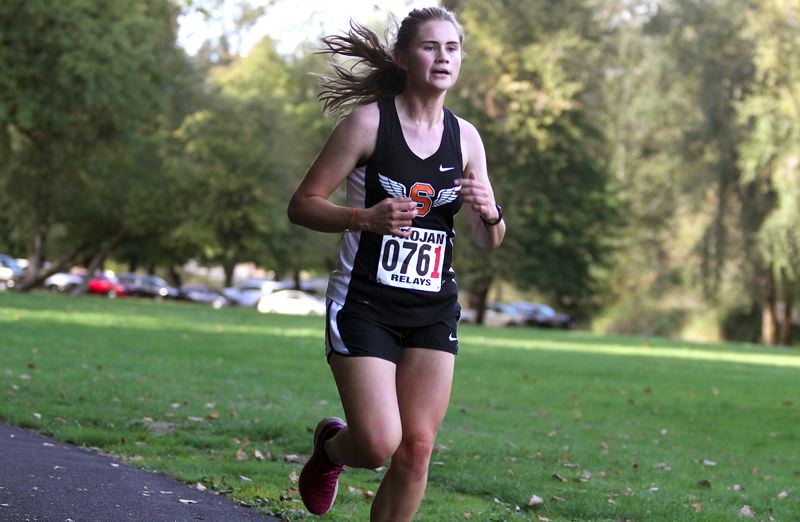 SPOTLIGHT PHOTO: MILES VANCE - Scappoose senior Anne Morud had her team's best time during the Trojan Relays at Trojan Park in Rainier on Oct. 4.
