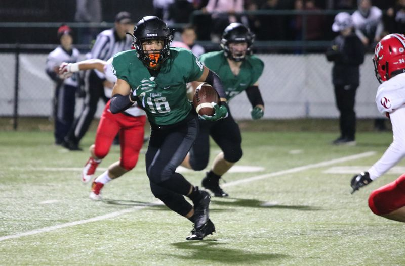 PMG PHOTO: JIM BESEDA - Tigard junior Max Lenzy returns a kick during Friday's game. Lenzy also had a 68-yard touchdown reception in the Tigers' 62-27 win over Oregon City.