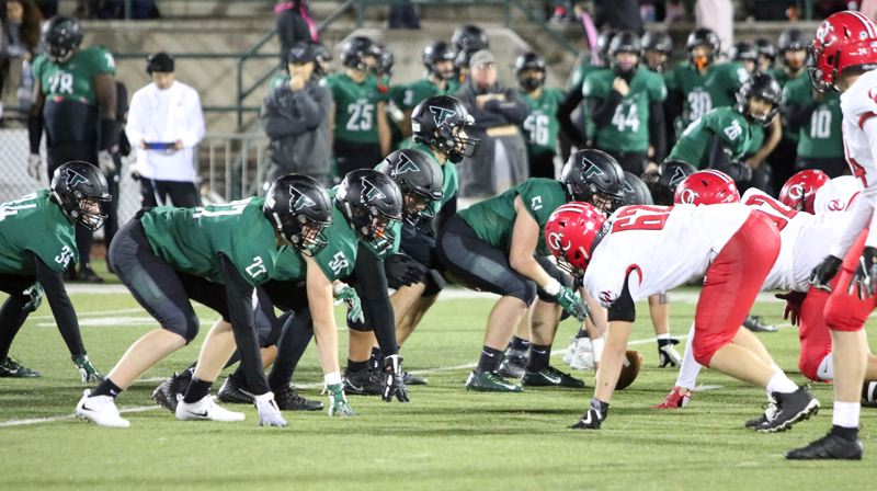 PMG PHOTO: JIM BESEDA - Tigard's offensive line paved the way for a running game that netted 314 yards on 44 carries Friday.