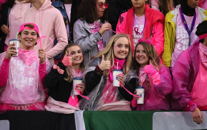 PMG PHOTO: JIM BESEDA - Tigard fans celebrated the annual 'Pink Out' night during the Tigers' 62-27 win over Oregon City on Friday.