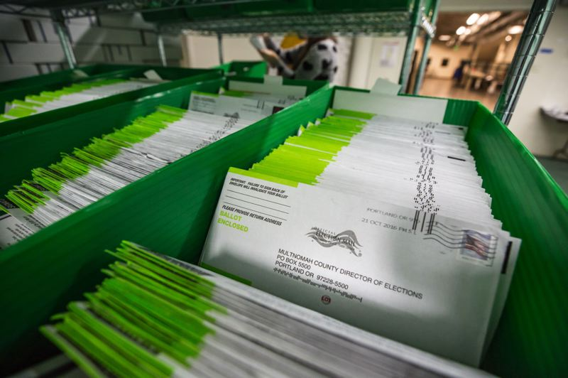 FILE PHOTO - Ballots await counting at the Multnomah County elections office in 2016.