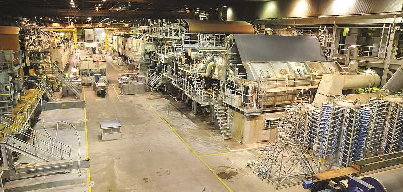 GRAPHIC FILE PHOTO - The giant papermaking machines at the mill in Newberg have set idle since fall of 2015, when WestRock shuttered the plant and laid off more than 200 workers.