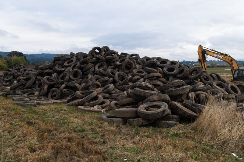 STAFF PHOTO: CHRISTOPHER OERTELL - Many residents and passersby have expressed curiosity about the mounds of tires excavated by work crews at the Spring Hill Natural Area this fall.