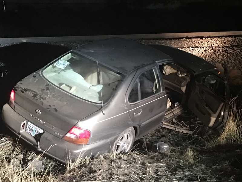 PHOTO COURTESY OF DESCHUTES COUNTY SHERIFF'S OFFICE - Police chase comes to a halt when suspect's vehicle is unable to go over the railroad tracks.