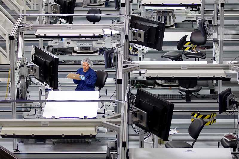 STAFF FILE PHOTO - SolarWorld, a solar panel manufacturer on Evergreen Parkway, nearly shut down this year. It was purchased by a California competitor last week.
