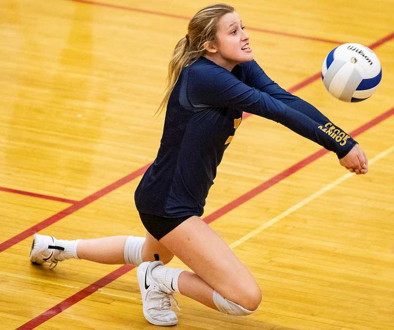LON AUSTIN/CENTRAL OREGONIAN - Kacie Stafford passes a ball during the Clearwater Classic on Saturday. Stafford finished with 38 digs during the tournament as the Cowgirls lost to North Medford in the silver bracket finals.