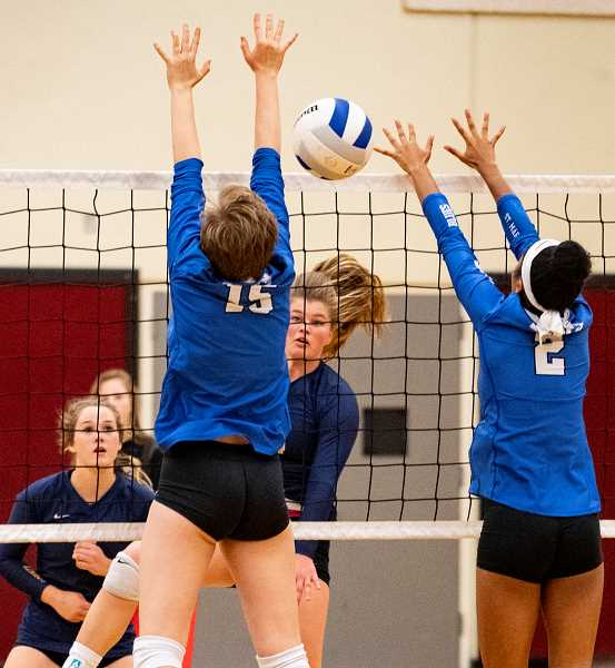 LON AUSTIN/CENTRAL OREGONIAN - Kenna Woodward goes up for a kill against St. Mary's Academy on Saturday at the Clearwater Classic, while Raegan Wilkins covers behind her. Woodward finished with 29 kills in the tournament, while Wilkins led the team with 53.