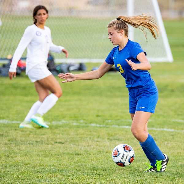LON AUSTIN/CENTRAL OREGONIAN - Faith Wagner plays a ball during a match earlier this year. Wagner scored one of three Cowgirl goals against the Redmond Panthers on Thursday as the two teams played to a 3-3 tie in Intermountain Conference play.