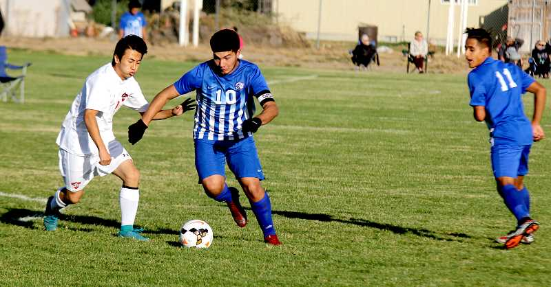 STEELE HAUGEN - Andres Acuna blows by a Corbett defender. He scored two goals in the Buffs' 2-0 win Oct. 4.