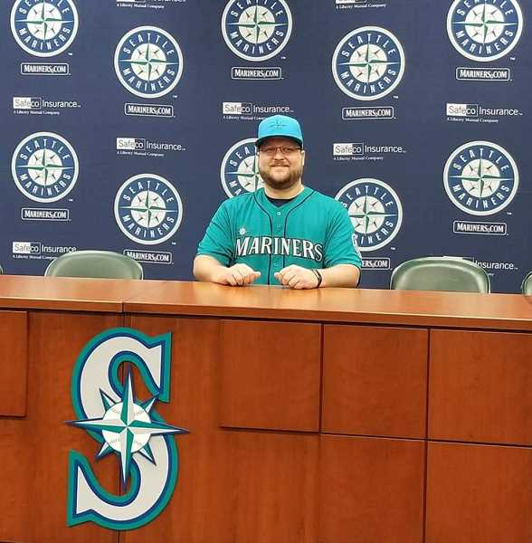 COURTESY PHOTO - Hillsboro's Dwayne Anliker poses for a photo as part of the Mariners' Ultimate Fan proceedings prior to their game Friday, Sept. 28, at Safeco Field in Seattle.