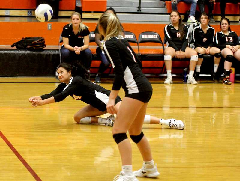 STEELE HAUGEN - Irma Retano dives for the ball during their home tourney Oct. 4.