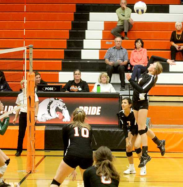 STEELE HAUGEN - Claire Bender makes a play for Culver. She led the team in aces with 12 against Delphian.