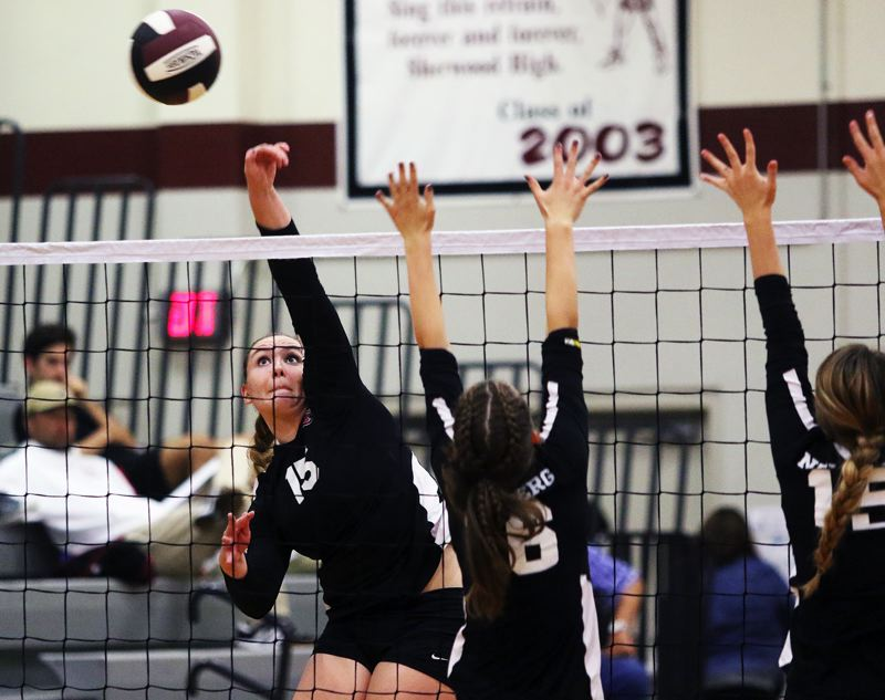 TIMES PHOTO: DAN BROOD - Sherwood senior Alyssa Haslip (15) hits a shot over the net during the first set of the Lady Bowmen's match with Newberg on Monday.