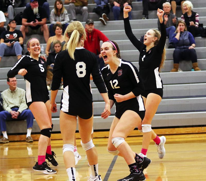 TIMES PHOTO: DAN BROOD - Sherwood's (from left) Piper Harrop, Clarie McGill, Josie Wilson and Alli Douglass celebrate following the team's come-from-behind fourth-set win over Newberg.
