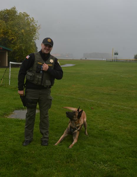 SPOTLIGHT PHOTO: COURTNEY VAUGHN - Columbia County Sheriff's deputy Cody Pesio poses with Lars a Sheriff canine deputy.