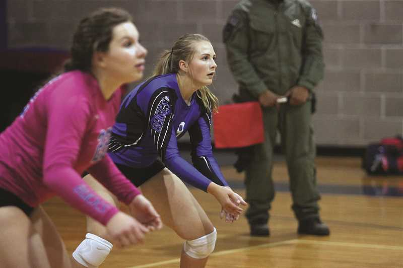 PHIL HAWKINS - St. Paul seniors Emma Connor and Megan Tuck prepare to defend against the oncoming service at Crosshill Christian High School on Thursday. The hosting Eagles gave the Bucks one of their strongest games in the Casco League this season.